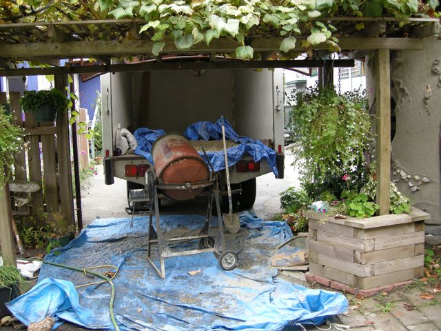 The cement mixer under the grape arbor